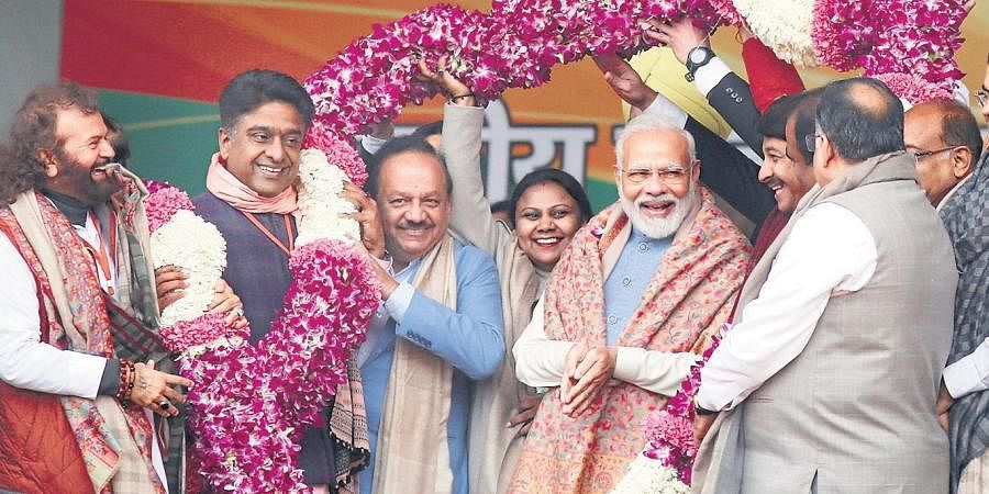 Prime Minister Narendra Modi along with BJP leaders Manoj Tiwari, Meenakshi Lekhi, Harsh Vardhan, Vijay Goel, Hansraj Hans, Gautam Gambhir and others during a rally at Ramlila Maidan, in New Delhi on Sunday.
