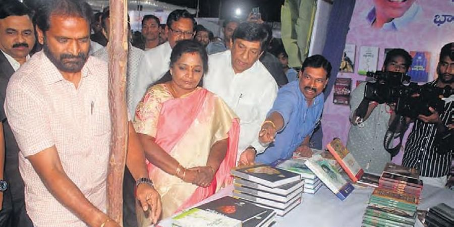 Governor Tamilisai Soundararajan going around the stalls after inaugurating the 33rd Hyderabad National Book Fair at NTR Stadium on Monday