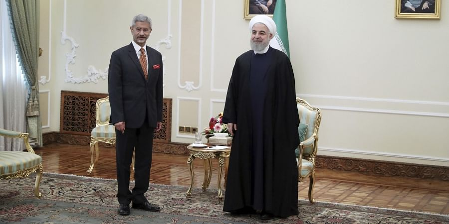 Iranian President Hassan Rouhani (R) waits to welcome an Indian delegation after welcoming Indian Foreign Minister Subrahmanyam Jaishankar for their meeting in Tehran Iran Monday Dec. 23 2019. (Photo   AP)