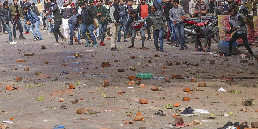 Protestors pelt stones at police personnel after their clash during a rally against NRC and amended Citizenship Act in Lucknow Thursday Dec. 19 2019. (Photo   PTI)