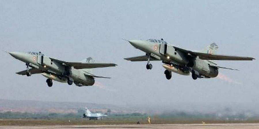 Two Indian Air Force MiG-27 UB take off while a French Air Force Mirage-2000 fighter awaits its turn during the Indo-France joint air force excercise 'Garuda' in Gwalior 12 February 2003, in Madhya Pradesh state. (File | AFP)