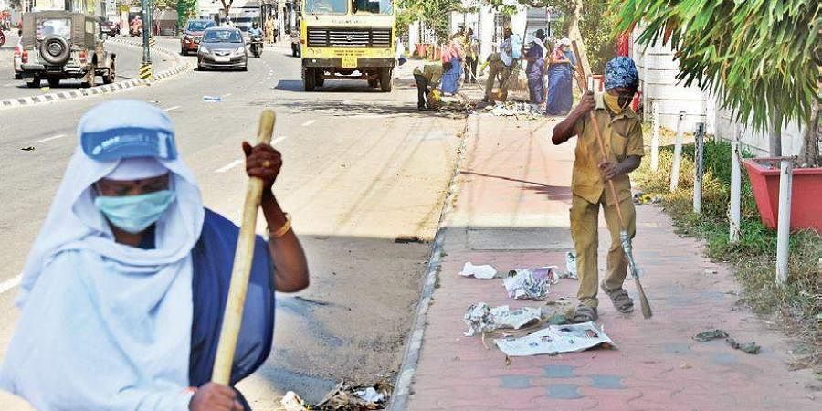 Sanitation workers cleaning the streets.