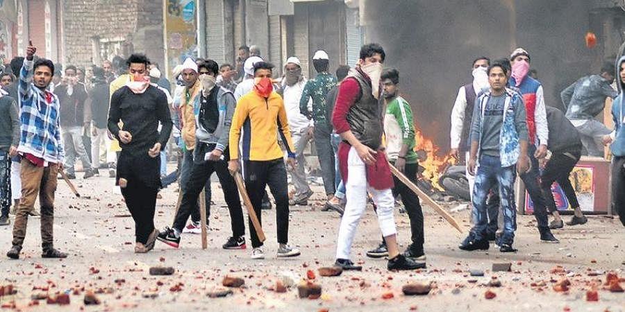 Protesters turn violent and throw brickbats during a rally in Muzaffarnagar, Uttar Pradesh on Friday