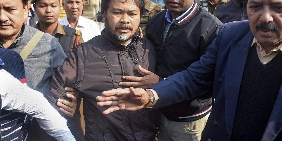 Krishak Mukti Sangram Samiti (KMSS) advisor Akhil Gogoi being produced at an NIA court in Guwahati