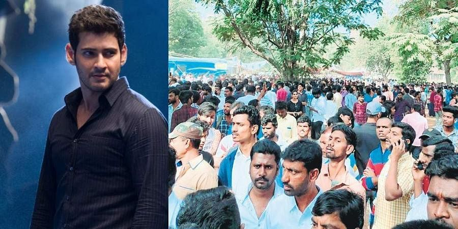 Fans wait for their turn for a photo shoot with superstar Mahesh Babu at Chandanagar in Hyderabad on Wednesday.
