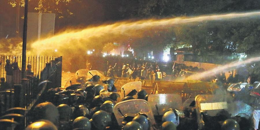 Police use water cannons during an agitation against the Citizenship (Amendment) Act at Daryaganj