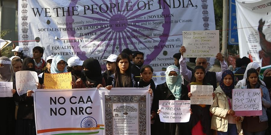 Protestors including students and local residents during a demonstration against the Citizenship Amendment Act CAA outside Jamia Millia Islamia University in New Delhi on Sunday.