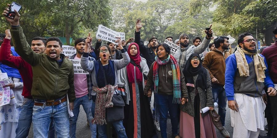 Protestors take part in a march demanding for the release of their leader Chandrasekhar Azad and protest against the amended Citizenship Act, NRC and NPR, in New Delhi, Friday, Dec. 27, 2019.