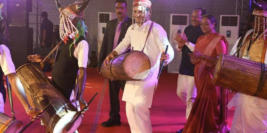 Rahul Gandhi shakes a leg with tribal community in Chhattisgarh