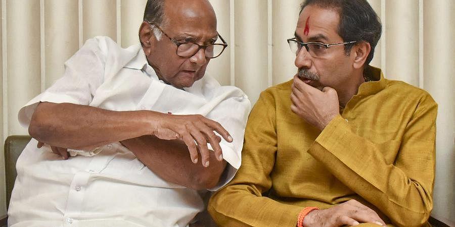 Shiv Sena chief Uddhav Thackeray with NCP chief Sharad Pawar