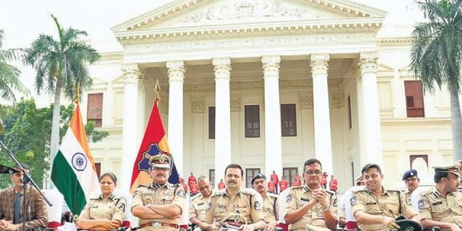 City Commissioner of Police Anjani Kumar along with other officers during the annual media conference at Koti Womens' College in Hyderabad on Thursday.
