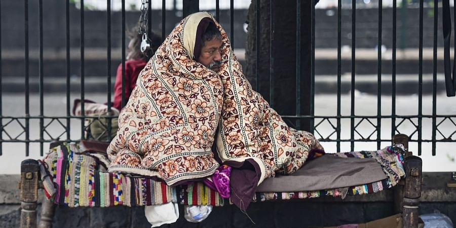 A man wrapped in woollens in cold winter morning in New Delhi Sunday Dec. 29 2019. (Photo | PTI)