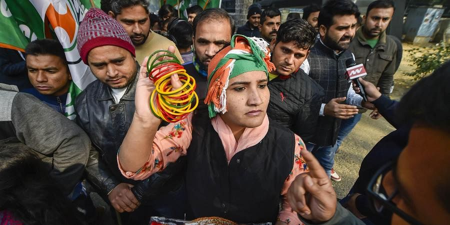 Members of Indian Youth Congress during a protest against the alleged manhandling of Congress general secretary Priyanka Gandhi by Uttar Pradesh police at UP Bhawan in Delhi Sunday Dec. 29 2019. (Photo | PTI)