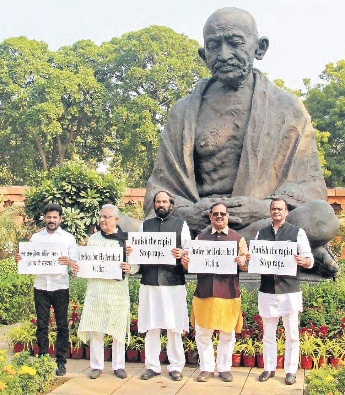 (From left) Malkajgiri MP A Revanth Reddy, Rajya Sabha MP MA Khan,  Nalgonda MP Uttam Kumar Reddy,  AICC Telangana in-charge RC Khuntia and Bhongir MP Komatireddy Venkat Reddy stage a dharna before Mahatma Gandhi's statue on the Parliament premises seeking justice for Disha's family