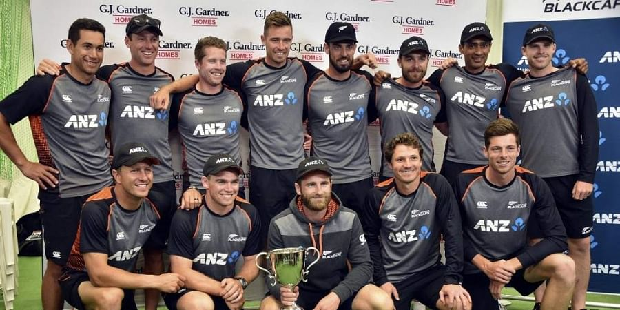 New Zealand players pose with the trophy after winning the cricket Test series between England and New Zealand at Seddon Park in Hamilton. (Photo | AFP)
