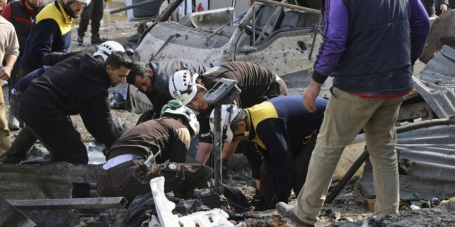 Syrian Civil Defense transporting an injured person after an airstrike hit the northern town of Maaret al-Numan, in Idlib province, Syria, Monday, Dec. 2, 2019.