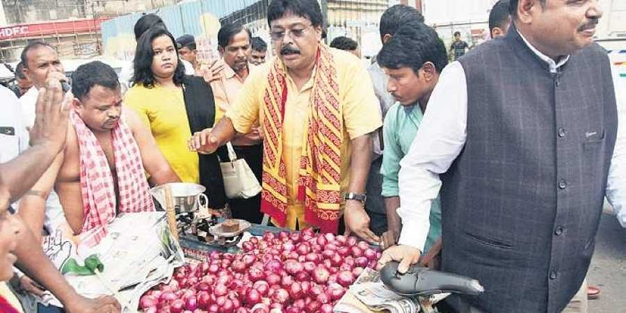 Congress workers selling onions at Station Square on Monday | Biswanath Swain