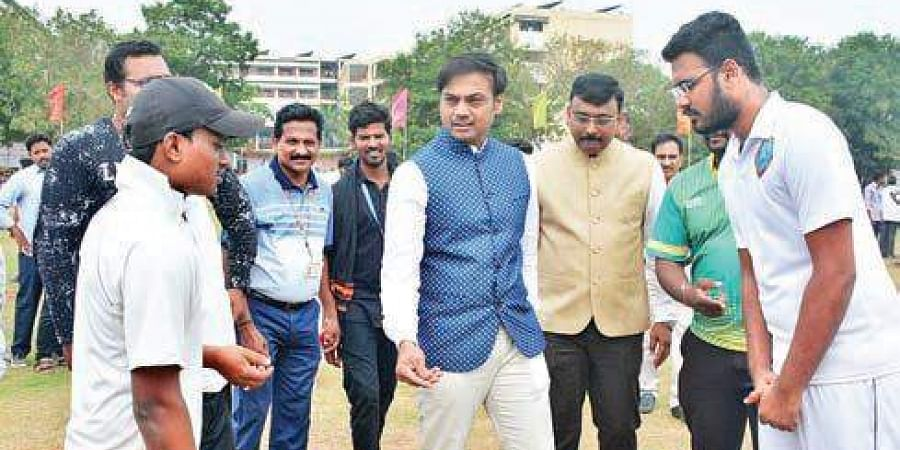 BCCI chief selector MSK Prasad tosses the coin as he inaugurates Pharma Cricket Championship at Vadlamudi in Guntur on Monday