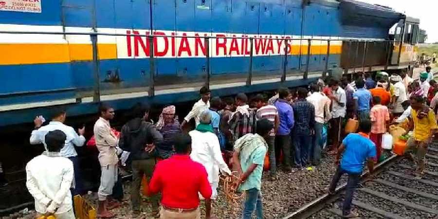 WATCH | After railway engine leaks midway, people throng to collect diesel in Karnataka...