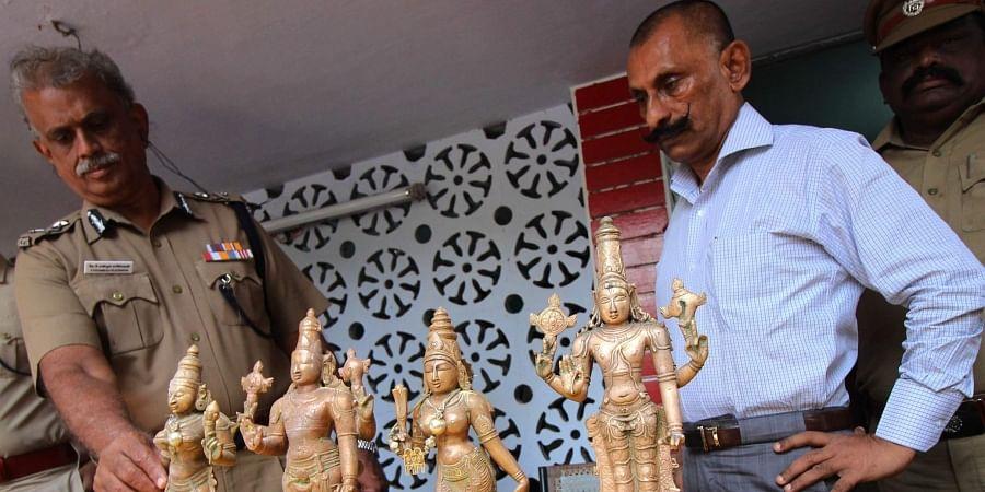File image of Pon Manickavel and Shanmuga Rajeswaran IG south zone seen along with the recovered Panchaloha idols at Sozhavandhan police station in Madurai district. (File photo   EPS)
