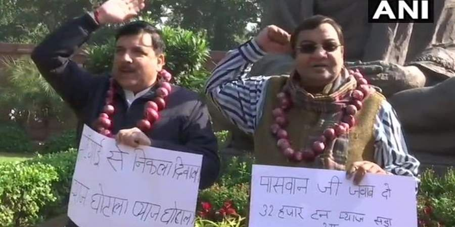 AAP MPs Sanjay Singh and Dr Sushil Gupta protesting in Parliament premises against rise in onion prices.