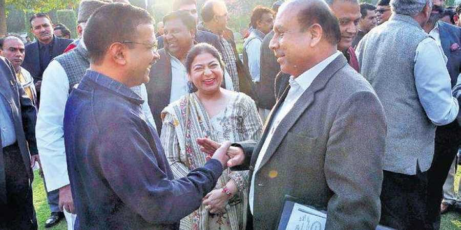 Chief Minister Arvind Kejriwal exchanges pleasantries with Leader of Opposition in the Assembly Vijender Gupta at the Vidhan Sabha.