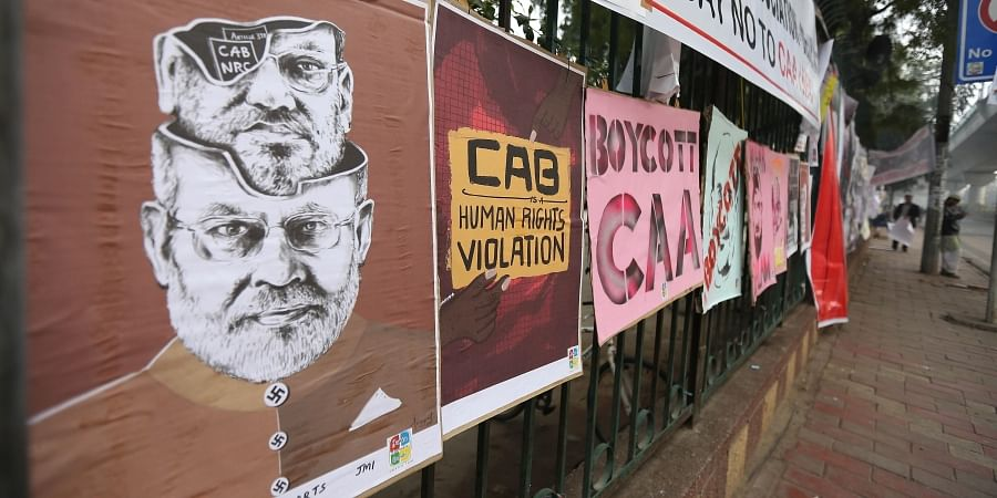 Banner pasted on a wall during a protest against Citizenship Act outside the Jamia Millia Islamia university in New Delhi on Sunday. (Photo | Arun Kumar P/EPS)