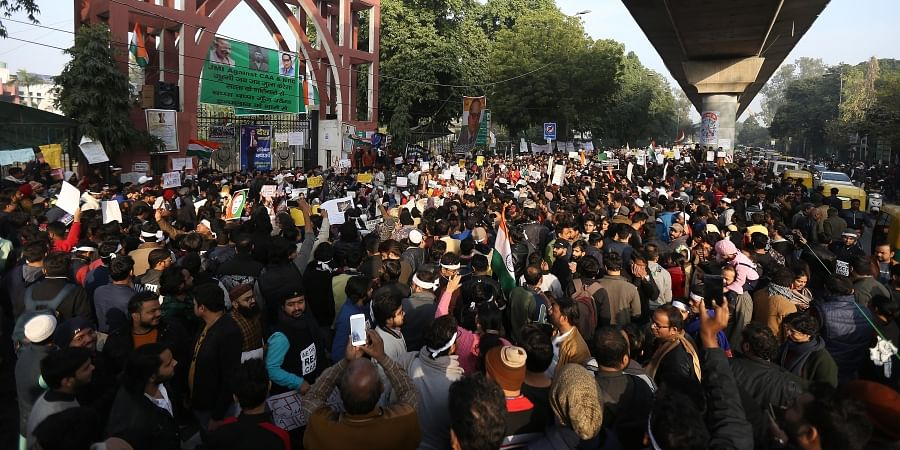 Protestors including students and local residents during a demonstration against the Citizenship Amendment Act CAA outside Jamia Millia Islamia University in New Delhi on Saturday