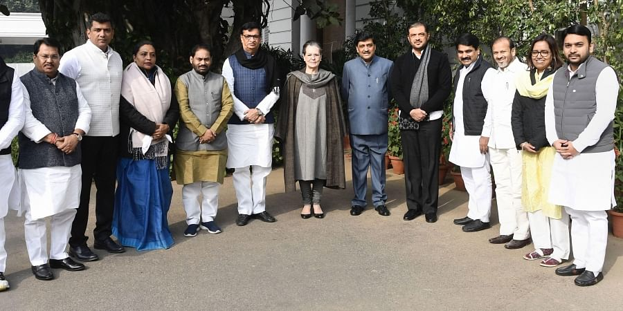 Congress interim president Sonia Gandhi poses for a group photo with party leaders who were appointed as ministers during the cabinet expansion of Maharashtra alliance government in New Delhi Tuesday Dec. 31 2019. (Photo   PTI)