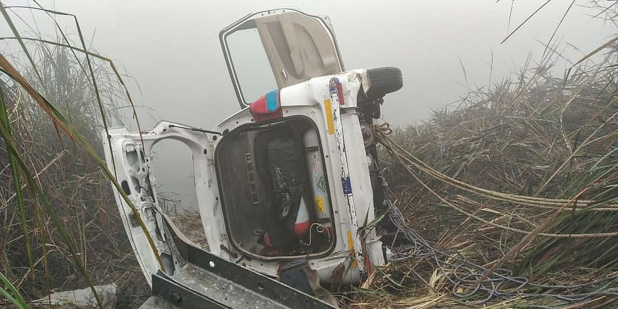 Mangled remains of a car after it fell into a canal in Noida Monday Dec. 30 2019. (Photo   PTI)