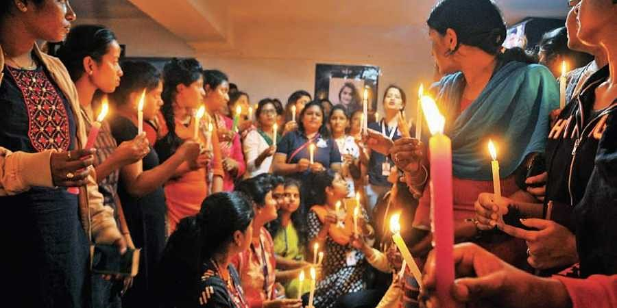 Women techies take out a candlelight rally demanding justice for Disha's family, at Hitec City on Tuesday.