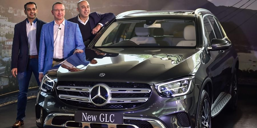 Mercedes Benz India MD and CEO Mercedes Benz India Martin Schwenk C poses for photographs during the launch of SUV 'GLC' in New Delhi