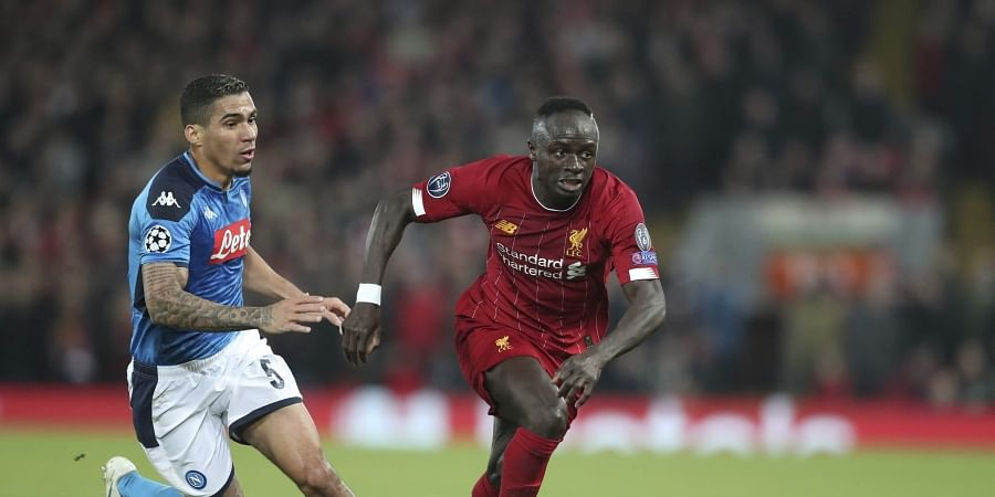 Liverpool's Sadio Mane, right, competes for the ball with Napoli's Allan during the Champions League Group E soccer match between Liverpool and Napoli at Anfield stadium in Liverpool, England, Wednesday, Nov. 27, 2019. (Photo | AP)