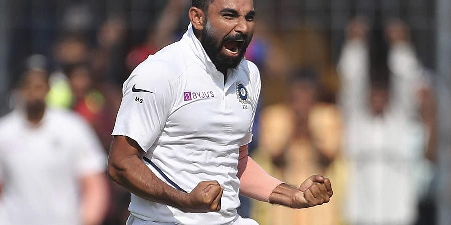 India's Mohammed Shami celebrates the dismissal of Bangladesh's Mehidy Hasan during the first day of first cricket test match between India and Bangladesh in Indore, India, Thursday, Nov. 14, 2019. | (Photo | AP)