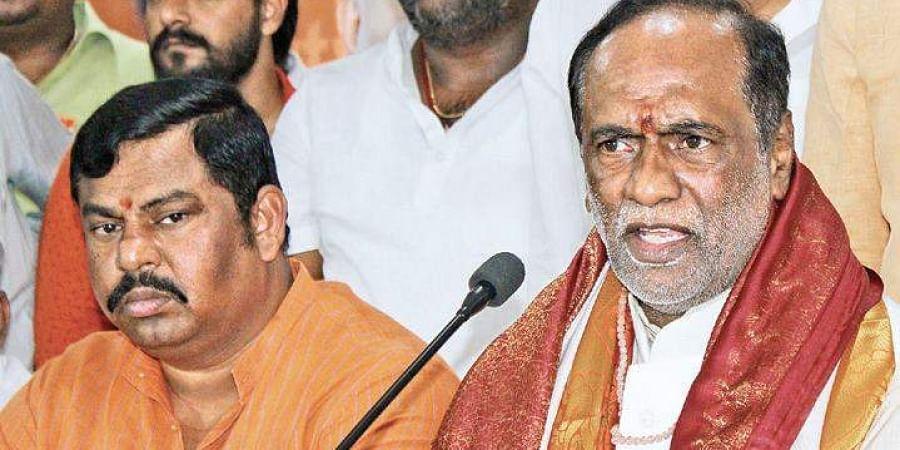 BJP State unit president K Laxman (R) and Goshamahal MLA T Raja Singh
