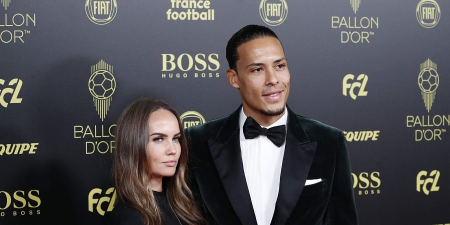 Liverpool's Virgil van Dijk poses with his wife Rike Nooitgedag during the Golden Ball award ceremony at the Grand Palais in Paris, Monday, Dec. 2, 2019.  (Photo | AP)