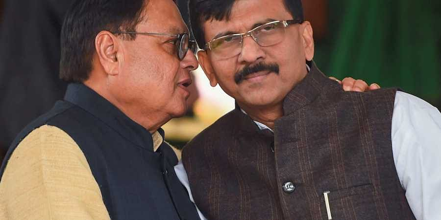 Shiv Sena MP Sanjay Raut (R) with former Rajya Sabha MP Vijay Darda during the ongoing Winter Session at Parliament in New Delhi Wednesday Dec. 4 2019. (Photo | PTI)