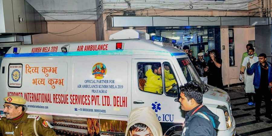 An ambulance carrying the Unnao rape survivor who was set afire earlier today arrives at Safdarjung Hospital after the state government arranged an air ambulance from Lucknow in Delhi Thursday Dec. 5 2019. (Photo | PTI)