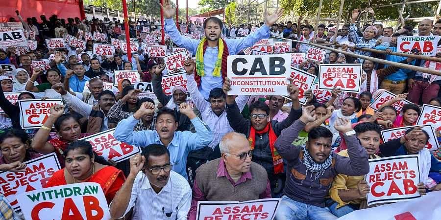 Activists of Krishak Mukti Sangram Samiti KMSS adviser Akhil Gogoi and others raise slogans during a protest against the Citizenship Amendment Bill CAB in Guwahati Thursday