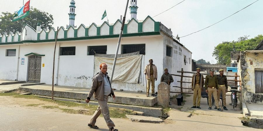 Policemen stand guard outside Terhi Bazaar Masjid on the eve of the 27th anniversary of the Babri Masjid demolition in Ayodhya Thursday Dec. 5 2019. (Photo | PTI)
