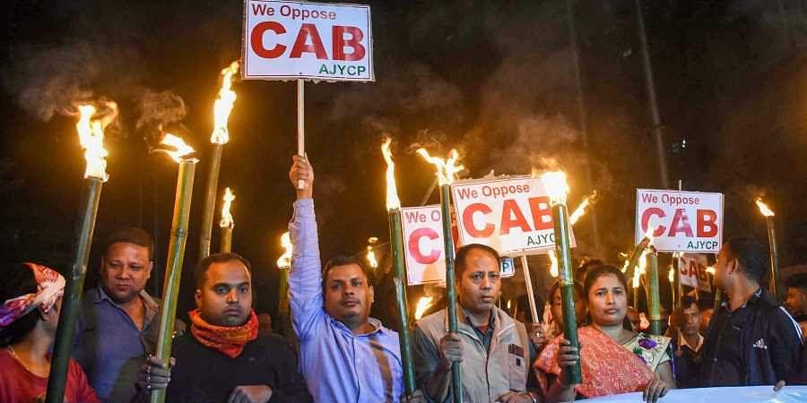 Asom Jatiyatabadi Yuba Chatra Parishad AJYCP members participate in a torchlight rally to protest against Citizenship Amendment Bill in Guwahati Thursday