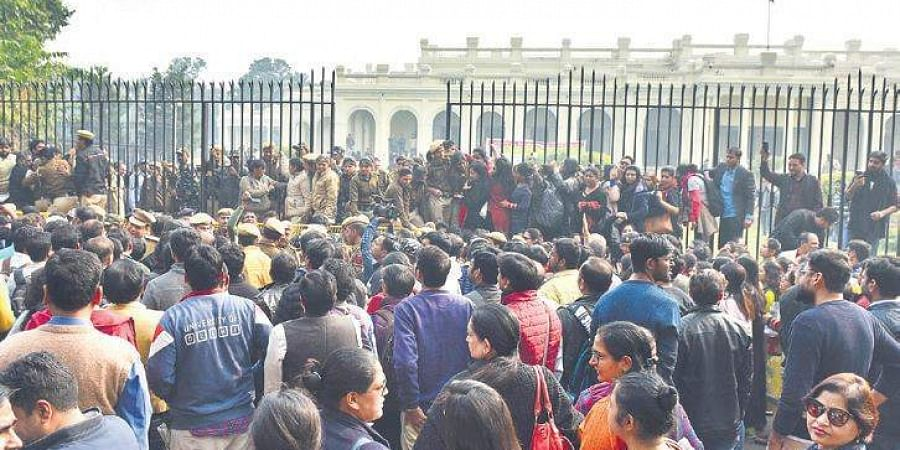 Members of Delhi University Teachers Association protest outside the VC's office demanding withdrawal of the circular mandating appointment of guest teachers, in New Delhi on Thursday.