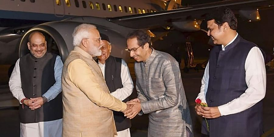 Prime Minister Narendra Modi being welcomed by chief minister of Maharashtra Uddhav Thackeray on his arrives at Pune Friday Dec. 6 2019. (Photo | PTI)