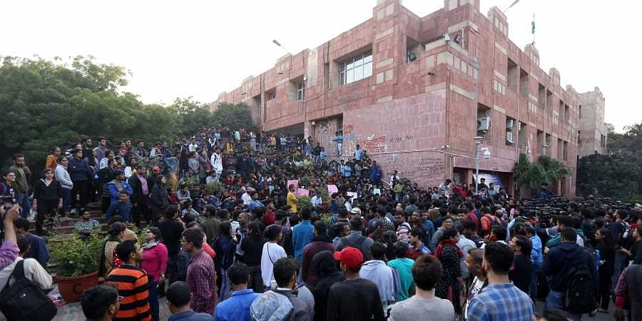 JNU students and their leaders who got injuries in Mondays police lathicharge shout slogans during a press conference at the university campus in New Delhi Tuesday Nov 19 2019. | (Photo | Arun Kumar/EPS)