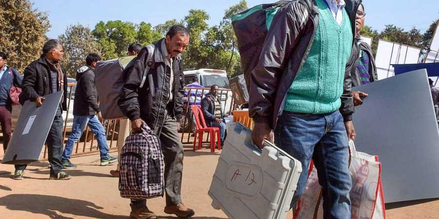 Polling officials carry EVM machines and other polling materials on the eve of the second phase of Jharkhand Assembly election in Ranchi. (Photo | PTI)