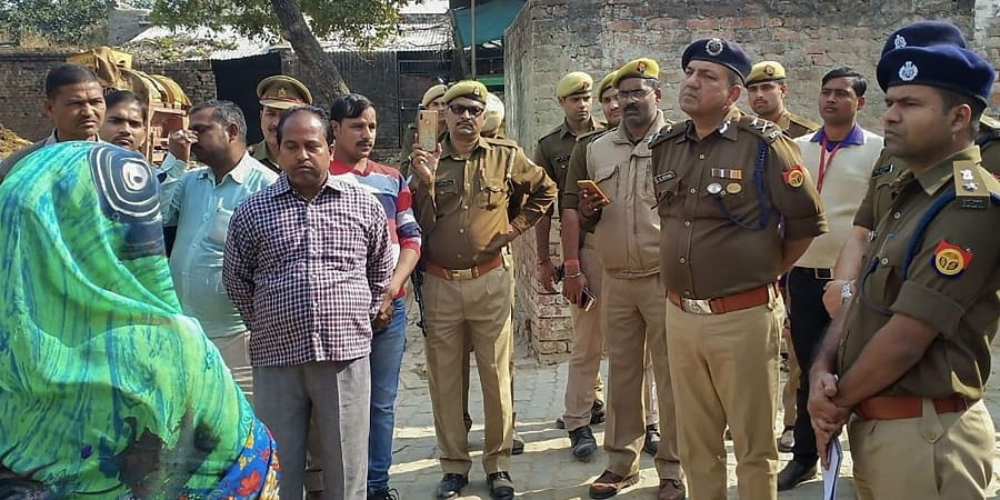 Police personnel investigate at the site where a rape victim was allegedly set ablaze by five men at Sindupur village in Unnao district Thursday Dec. 5 2019. (Photo   PTI)