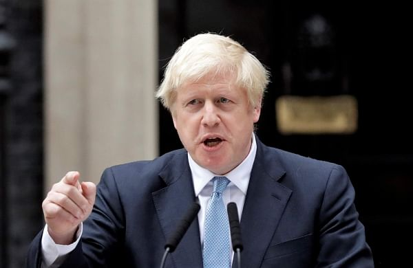 UK PM Johnson visits Hindu temple, vows to partner with PM Modi to build new India