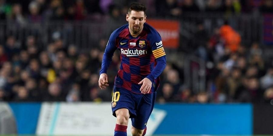 Barcelona's Argentine forward Lionel Messi runs with the ball during the Spanish League football match between FC Barcelona and RCD Mallorca at the Camp Nou stadium in Barcelona. (Photo | AFP)