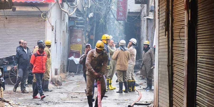 Firemen at the site of a fire in New Delhi.
