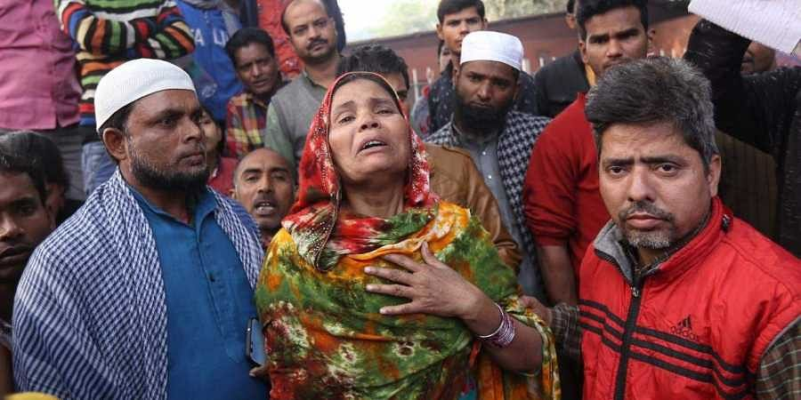 Family members of the Delhi fire deceased wailing at LNJP Hospital.